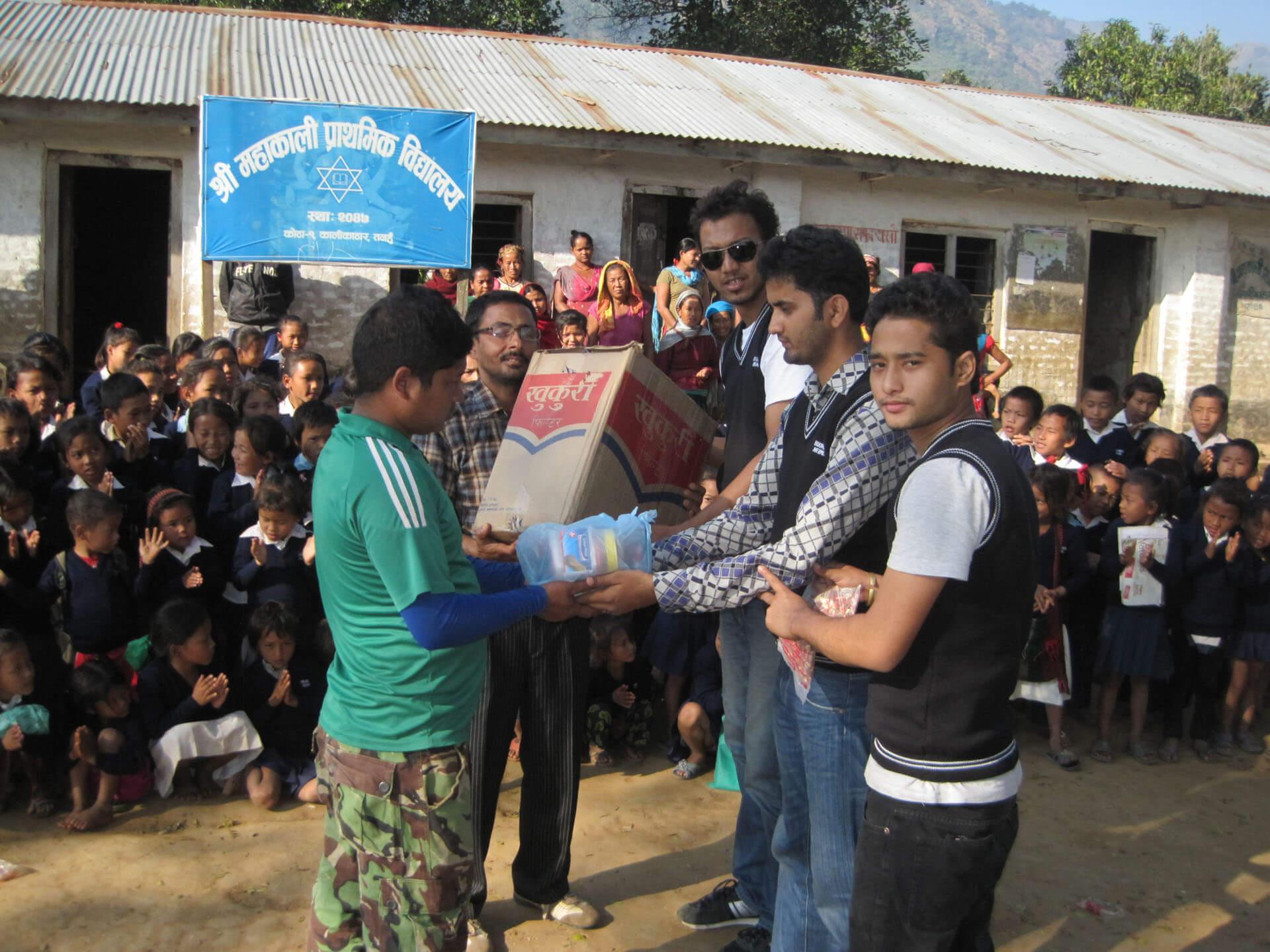 Nourish Nepal handing out sweaters at Mahakali school